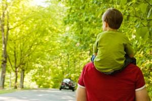 Boy riding Dad's shoulders