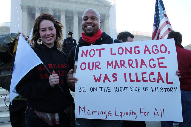 Lyssa and Kris show their support for same-sex marriage at a Marriage Equality Rally at the US Supreme Court, March 26, 2013.