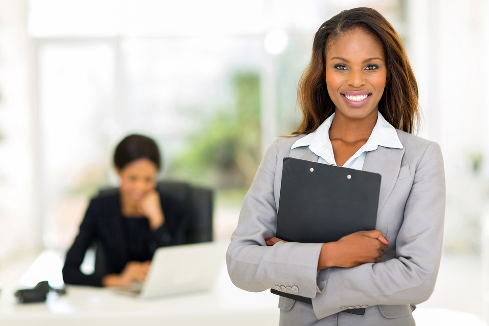 A female businesswoman smiling into the camera.