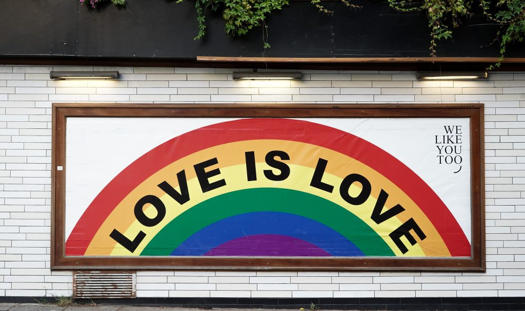"""a painting with the words """"love is love"""""""